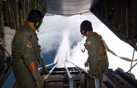 Malaysian Air Force personnel cloud seeding with chemical trails (chemtrails) in an effort to combat forest fires in 2005.  IMAGE SOURCE